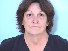 WOMAN ARRESTED FOR CHILD NEGLECT;  FLOOR INSIDE HOME FOUND COVERED IN FECES