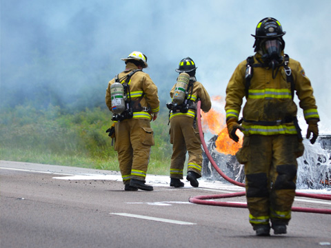 walton county fire rescue fighting a burning car near a road