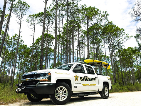 walton county sheriff truck with yellow surfboard on top