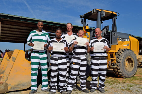 Convicts graduating heavy equipment training