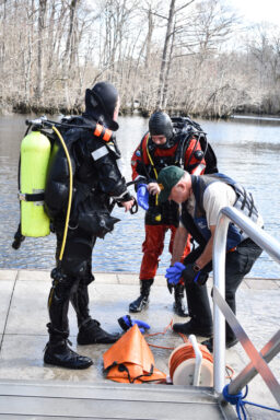 The Walton County Sheriff's Office Dive Team takes off their gear after locating the body of a missing person at Morrison Springs.