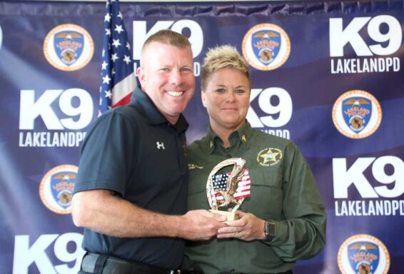 K9 Handler Kristin Pond smiles while receiving an award at the USPCA Region 1 K9 Trials