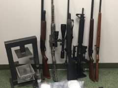 Guns, drugs, and a kilo press seized during traffic stop