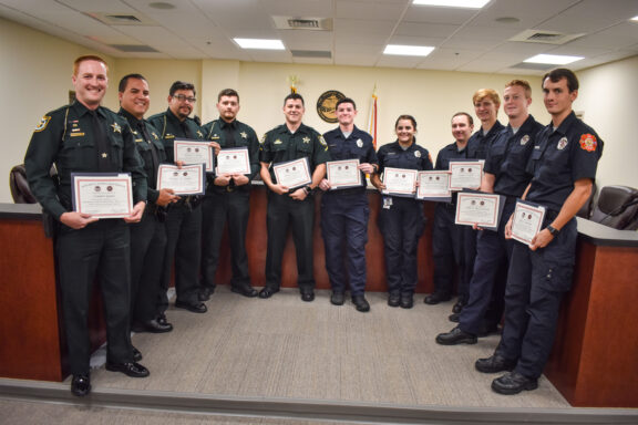 Eight firefighters and eight deputies from Walton County Sheriff's Office pose with their newly achieved EMT Certifications