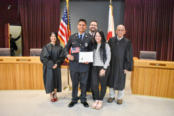 Osorio holding his US Citizen Certificate alongside his family.