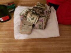 A PILE OF CASH CONFISCATED DURING WARRANT EXECUTION