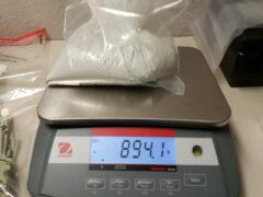 DRUGS BEING WEIGHED ON A SCALE