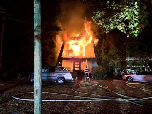 Three story home fully engulfed in flames