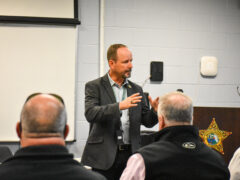 Walton County Jail Director Cory Godwin addresses attendees at the graduation ceremony.