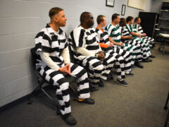 Inmates sit in a classroom at the jail during the welding graduation ceremony.