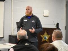 Bill Allison, the Director of Professional and Workforce Training at Northwest Florida State College addresses inmates.