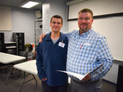 Steven Hurst poses with his welding instructor John Greehalgh.
