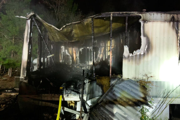Mobile home charred from structure fire
