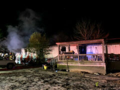 FIREFIGHTERS KNOCK DOWN FLAMES THREATENING TO CONSUME FAMILY'S HOME ON NEW YEAR'S EVE