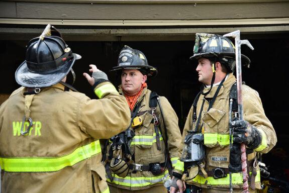 Firefighters in Bunker Gear and Helmets