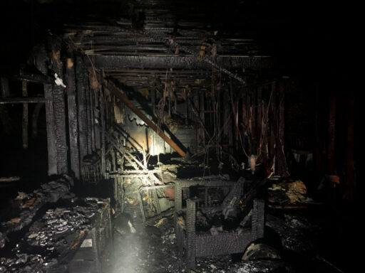 Heavy smoke damage to the interior of a mobile home because of a structure fire