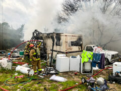 FIREFIGHTERS KNOCK DOWN FLAMES ENGULFING A RESIDENTIAL CAMPER IN MOSSY HEAD