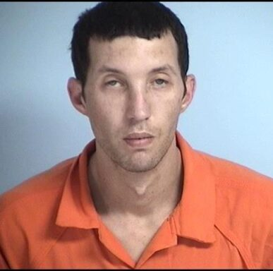 Mug shot of a white male with black hair and no facial hair.