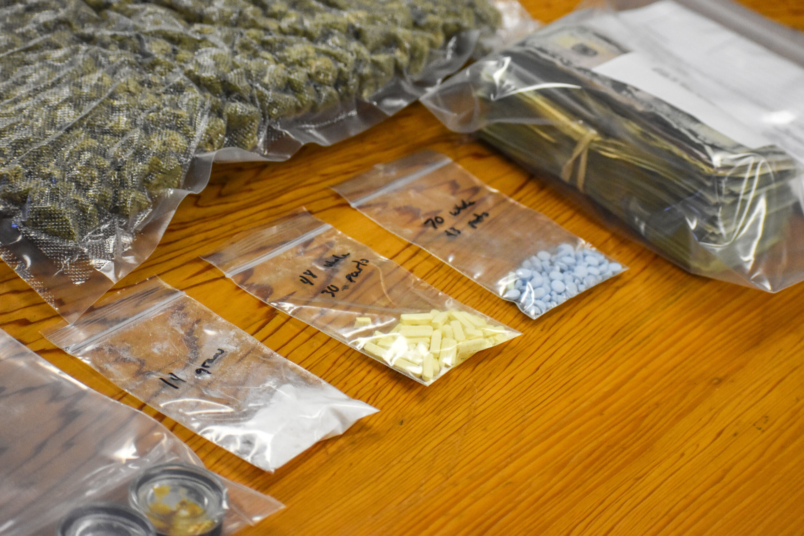 STOP SIGN VIOLATION LEADS TO DISCOVERY OF COCAINE, PILLS AND CASH