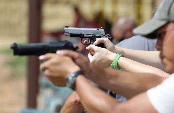 People holding pistols