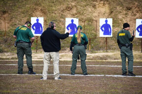 Instructor demonstrating how to shoot on a shooting range