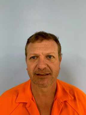 Mug shot of a white male with brown hair
