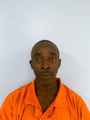 Mug shot of a black male in an orange jumpsuit