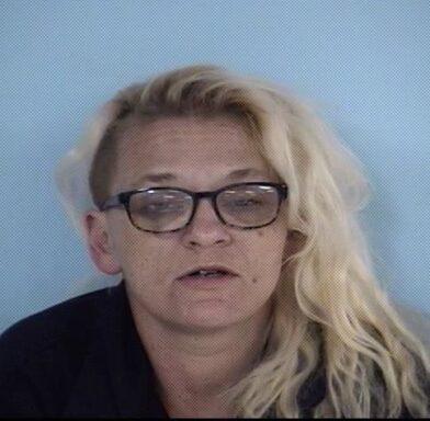 Mug shot of a blonde female with glasses