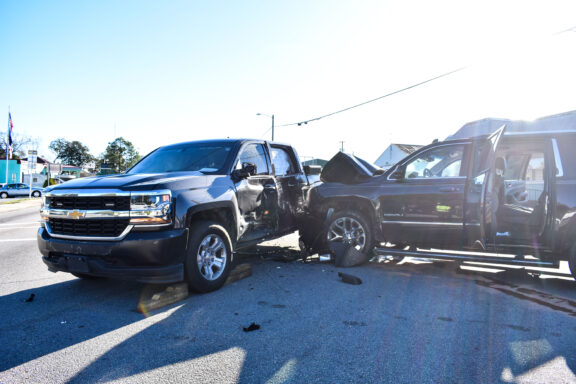 A traffic crash where an SUV slammed into a pick-up truck.