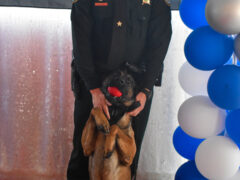Dog posing with his handler