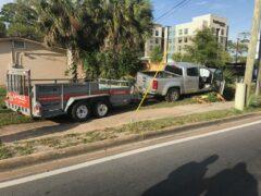 crashed truck with u-haul trailer
