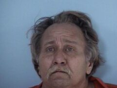 Mug shot of white male with graying hair