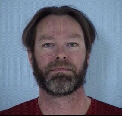Mug shot of a white male with gray and brown facial hair