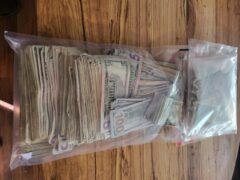 cash inside a plastic bag
