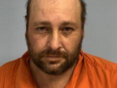 Mug shot of white male, balding with brown facial hair