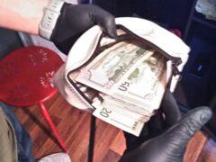 Cash inside a bank pouch